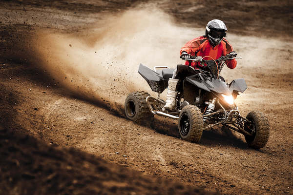 Photo of person driving ATV