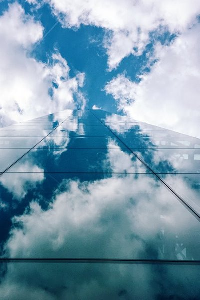 reflection-of-sky-on-skyscraper-windows