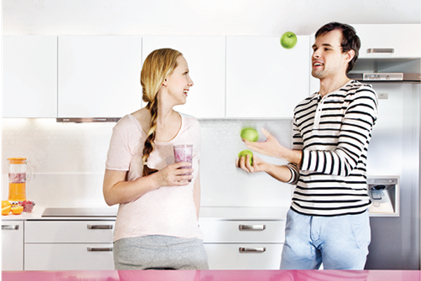 photo-of-man-and-woman-juggling-fruit