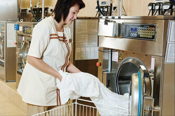 image-of-person-operating-industrial-laundry-machine