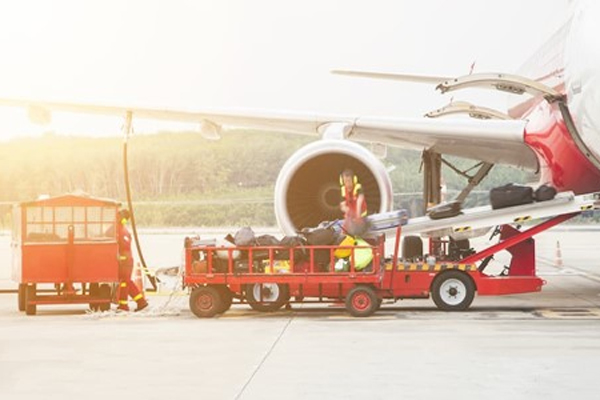 photo-of-truck -unloading-baggage-from-plane