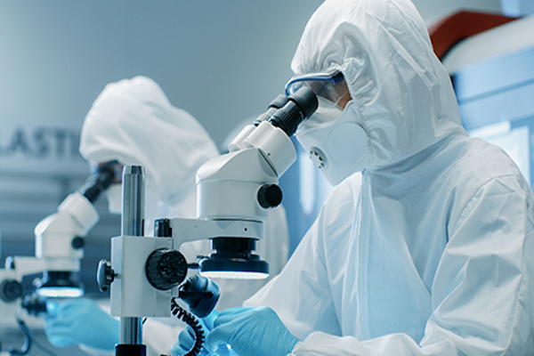 photo-of-medical-suits-looking-into-microscope
