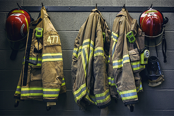 Photo of firefighter coats hanging